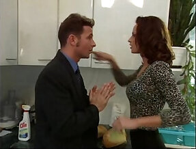 Wanda Curtis gets her throat fucked while cleaning the kitchen