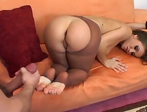 Fucking and footjob on a couch in nude pantyhose