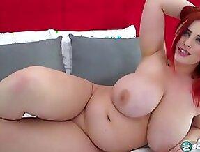 Redhead with huge boobs teasing
