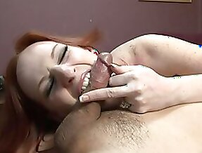 Redhead milf Audrey Lords sucks and rubs a small dick indoors